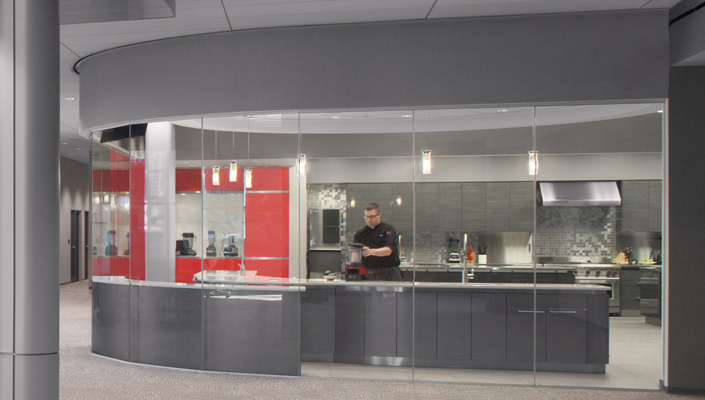 The Vitamix red entrance continues inside. Visitors can see and participate in demonstrations.