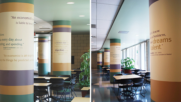Seven architectural columns feature inspiring business and innovation quotes in the student break area.