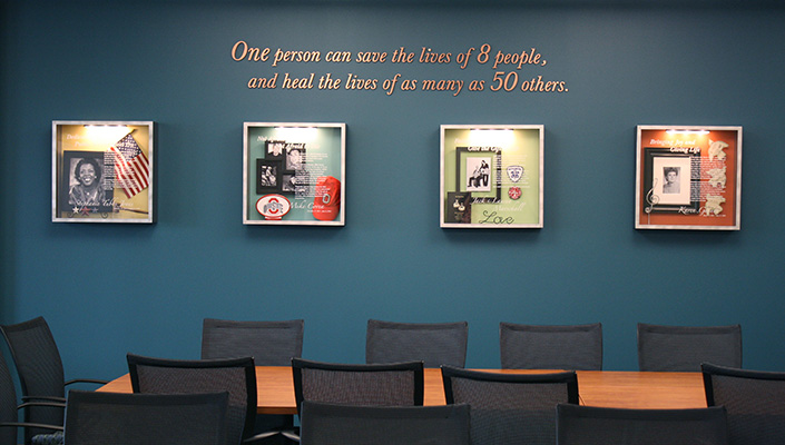 In the boardroom, eight custom-designed shadow boxes honor and tell each donor's life story.