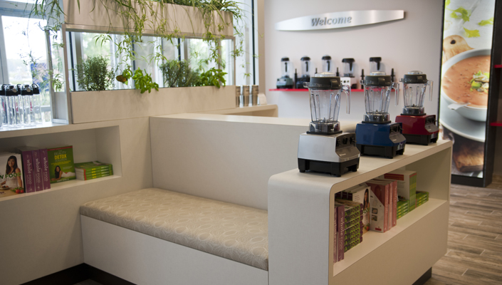 The seating area is designed to display product and features a fresh herb garden.