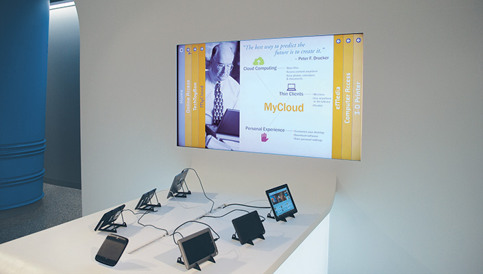 "The interactive monitor is located above the ""TechToyBox"" area. An array of the newest technology devices are available to try."