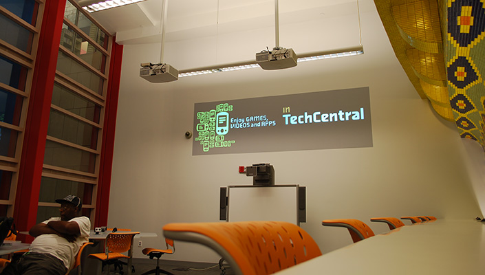 A dual-projected animation shuffles through a loop of 16 TechCentral features.