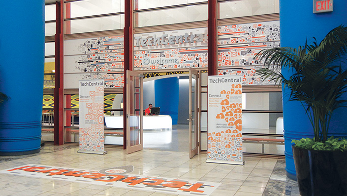 The expansive entrance with its mass of icons, compelling color palette and 15 ft. floor graphic announces TechCentral.
