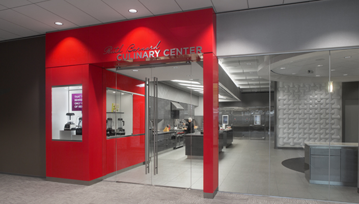 Vitamix red frames the entrance to the Ruth Barnard Culinary Center.