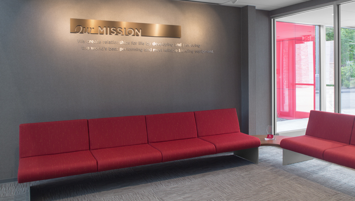 The company's Mission is highlighted above the visitor seating area in the Main Lobby.