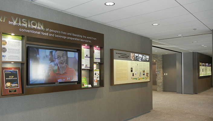 "The ""welcome"" wall and historical timeline introduces visitors to Vitamix. The back-lit timeline flanks the entrance to the new addition. One is 7 ft. long and the other is 12 ft. long."