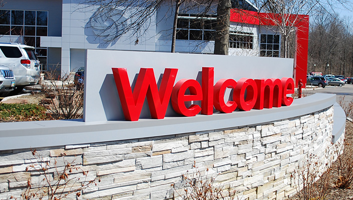 """Visitors are greeted with a Vitamix red dimensional """"Welcome"""" when approaching the main entrance."""