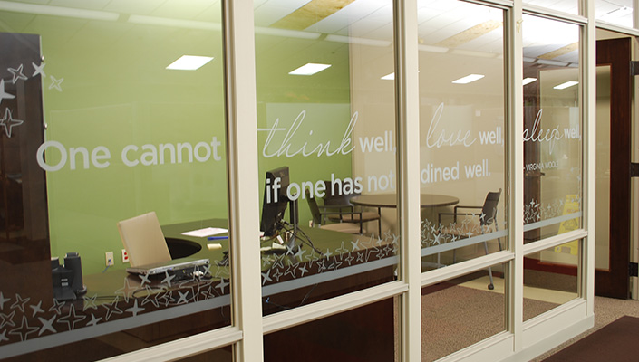 Culinary-inspired quotes appear on office windows to inspire and provide privacy.
