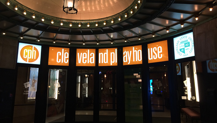 At night, the LED sign boxes display a bright brand identity in concert with the under-canopy theater lighting.
