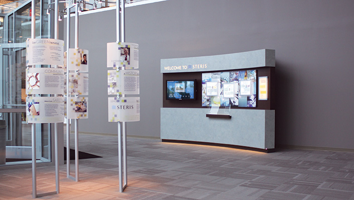 """The """"Info Towers"""" and """"Welcome Wall"""" in the main lobby provide a company overview with 18 individual content panels."""