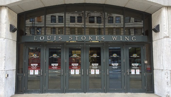 Louis Stokes Wing: main entrance stainless steel signage was refinished. Library logo, hours and safety signage added to each door.