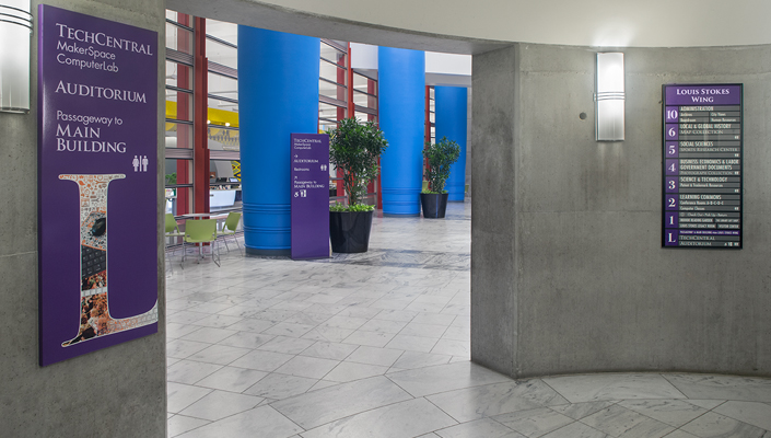 Louis Stokes Wing: wall-mounted level identification, directory and floor-stand directional signage.