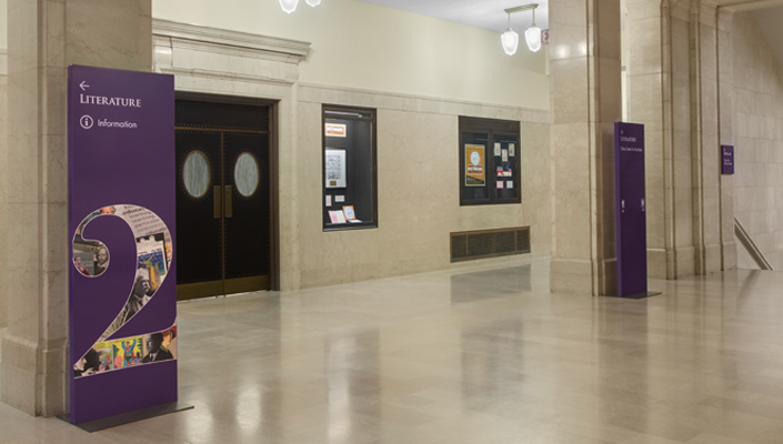 Main Building: floor-stand level identification and directional signs.