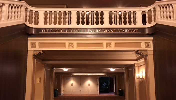 Donor recognition in the Ohio Theatre lobby is solid brass lettering and works in concert with the interior architecture.
