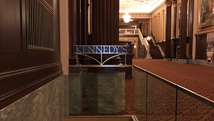 Kennedy's is  an intimate 100-seat performance venue. The signage is designed to be visible and in harmony with the space.